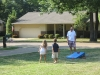 Ariel and Joshua playing corn hole with their uncles. Corn hole! Ha ha ha