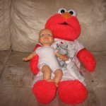 Elmo feeding the baby glue?